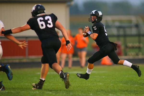 Quarterback Jett Engle runs to the outside to make a throw as Western HS defeats Hamilton Heights HS in their Friday night matchup on Sept. 20, 2019.<br /> Tim Bath | Kokomo Tribune