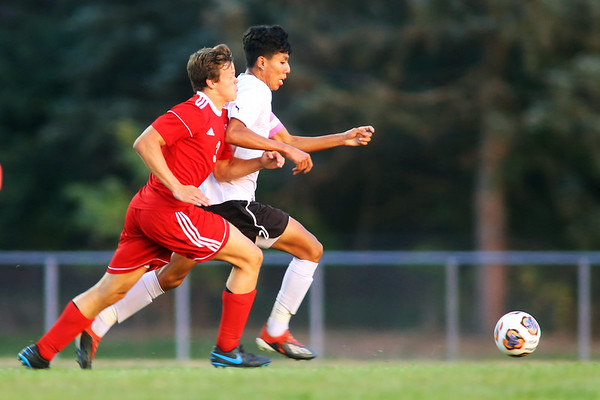 Logan Pitner goes after and stops Juan Perez during soccer action between Kokomo High School and Logansport High School on Sept. 17, 2019.<br /> Tim Bath | Kokomo Tribune
