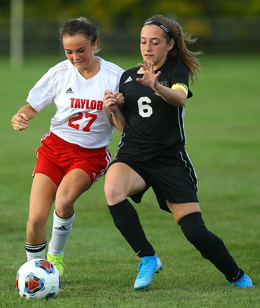 9-4-19<br /> Taylor vs Peru girls soccer<br /> Taylor's Delila Delgado and Peru's Abby Rogers go after the ball.<br /> Kelly Lafferty Gerber | Kokomo Tribune
