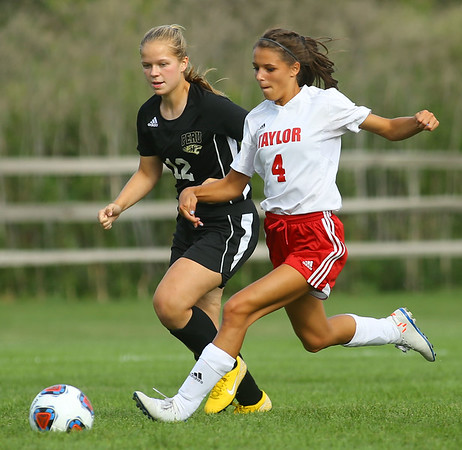 9-4-19<br /> Taylor vs Peru girls soccer<br /> Taylor's Alison Pemberton goes after the ball against Peru's Jenna Watkins.<br /> Kelly Lafferty Gerber | Kokomo Tribune