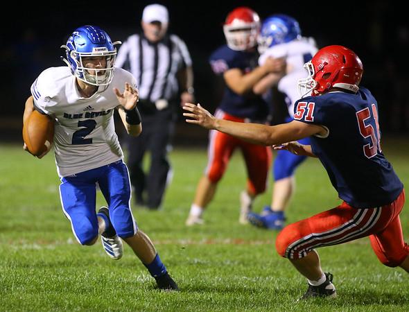 9-13-19<br /> Cass vs Tipton football<br /> Tipton's Sam Edwards looks to outrun Cass' Tyler Johnson.<br /> Kelly Lafferty Gerber | Kokomo Tribune