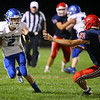 9-13-19<br /> Cass vs Tipton football<br /> Tipton's Sam Edwards looks to outrun Cass' Tyler Johnson.<br /> Kelly Lafferty Gerber | Kokomo Tribune