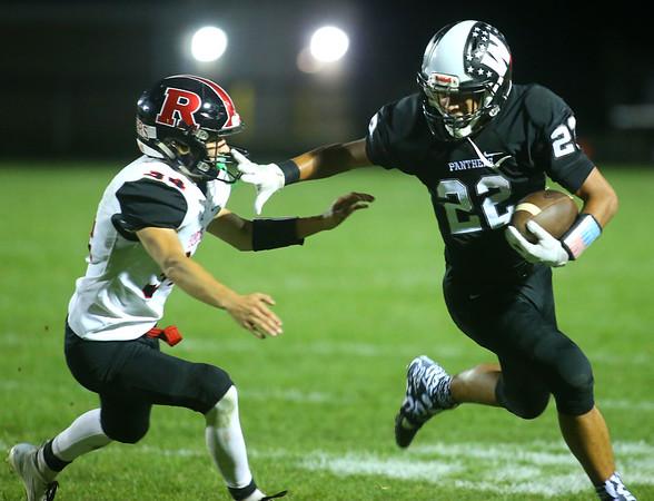 9-6-19<br /> Western vs Rensselaer football<br /> Western's Nathaniel Liddell runs out of the clutches of Rensselaer's Addison Wilmington.<br /> Kelly Lafferty Gerber | Kokomo Tribune