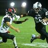 9-6-19<br /> Western vs Rensselaer football<br /> Western's Nathaniel Liddell runs out of the clutches of Rensselaer's Addison Wilmington.<br /> Kelly Lafferty Gerber   Kokomo Tribune