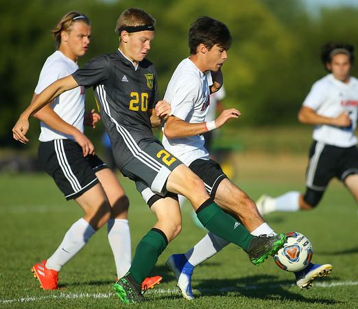 9-26-19<br /> Eastern vs Sheridan boys soccer<br /> Eastern's Evan Spell works the ball amidst Sheridan defenders.<br /> Kelly Lafferty Gerber | Kokomo Tribune