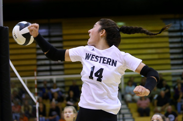 Taylor Scott sends the ball over with a fist during volleyball action between Western HS and Cass HS on Sept. 24, 2019. <br /> Tim Bath | Kokomo Tribune