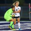 Kaitlyn Lagoni stops a shot by Western as Sophie Weigt runs into her as Western HS girls defeat Northwestern HS 3-0 on Sept. 19, 2019.<br /> Tim Bath | Kokomo Tribune