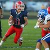9-13-19<br /> Cass vs Tipton football<br /> Cass' Caden Zeck runs the ball and pulls away from the pack.<br /> Kelly Lafferty Gerber | Kokomo Tribune