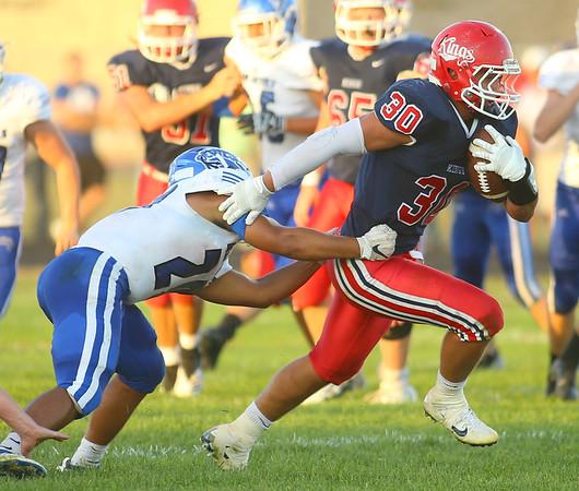 9-13-19<br /> Cass vs Tipton football<br /> Cass' Joey Humphrey looks to outrun Tipton's Jayvin Lyons.<br /> Kelly Lafferty Gerber   Kokomo Tribune