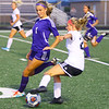 Northwestern's Emma O'Dell tries to stop Western's Lucy Weigt. Western HS girls defeat Northwestern HS 3-0 on Sept. 19, 2019.<br /> Tim Bath | Kokomo Tribune