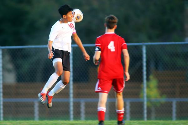 Logan's Juan Perez shoots during soccer action between Kokomo High School and Logansport High School on Sept. 17, 2019.<br /> Tim Bath   Kokomo Tribunes