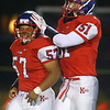9-27-19<br /> Kokomo vs Muncie Central football<br /> Kokomo's Nolan Hansen congratulates Myles Lenoir after Lenoir makes a good tackle.<br /> Kelly Lafferty Gerber | Kokomo Tribune
