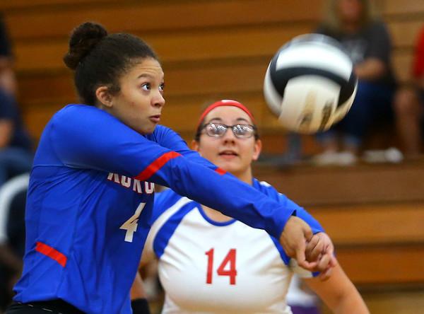 Jada-Claire Broomfield returning a wild ball as Kokomo High School volleyball team defeats North Miami High School on Sept. 18, 2019.<br /> Tim Bath | Kokomo Tribune