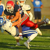 9-13-19<br /> Cass vs Tipton football<br /> Cass' Gabe Eurit tries to leap over Tipton's Nate Powell.<br /> Kelly Lafferty Gerber | Kokomo Tribune