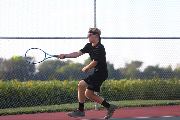 Clayton Griswold playing doubles for Northwestern Tennis against Rochester on Sept. 25, 2019. <br /> Tim Bath   Kokomo Tribune