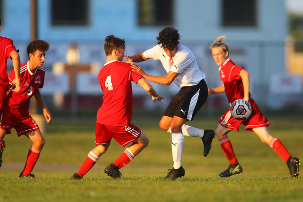 Logan's Lenny Casimiro tries to take the ball through the Kokomo defence during soccer action between Kokomo High School and Logansport High School on Sept. 17, 2019.<br /> Tim Bath | Kokomo Tribune