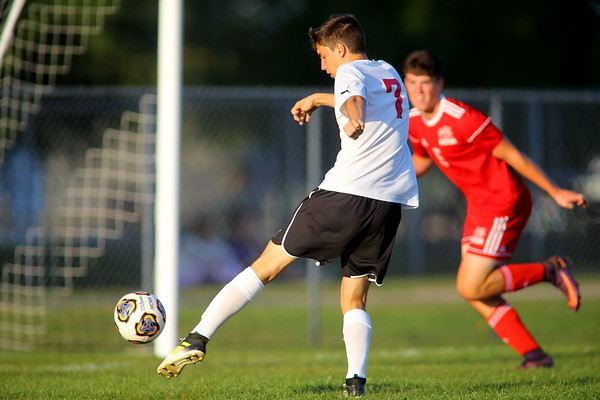 Logan's Pedro Ferrieira Silveira shoots during soccer action between Kokomo High School and Logansport High School on Sept. 17, 2019.<br /> Tim Bath | Kokomo Tribunes
