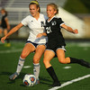 9-28-19<br /> Western vs Central Catholic girls soccer Hoosier Conference Tournament<br /> Western's Lucy Weigt, right, and Central Catholic's Caroline Lutz go after the ball.<br /> Kelly Lafferty Gerber | Kokomo Tribune