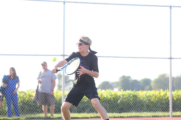 Clayton Griswold playing doubles for Northwestern Tennis against Rochester on Sept. 25, 2019. <br /> Tim Bath | Kokomo Tribune
