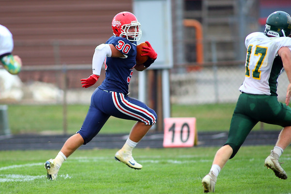 Joey Humphrey runs for a touchdown in the first quarter as  Lewis Cass High School football defeated Benton Central 68-0 on Sept. 6, 2019.<br /> Tim Bath | Kokomo Tribune