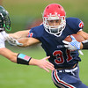 Gabe Eurit running for another Cass touchdown holding off Quentin Hardebeck as Lewis Cass High School football defeated Benton Central 68-0 on Sept. 6, 2019.<br /> Tim Bath | Kokomo Tribune