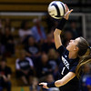 Hallee Rezo sends the ball over during volleyball action between Western HS and Cass HS on Sept. 24, 2019. <br /> Tim Bath | Kokomo Tribune