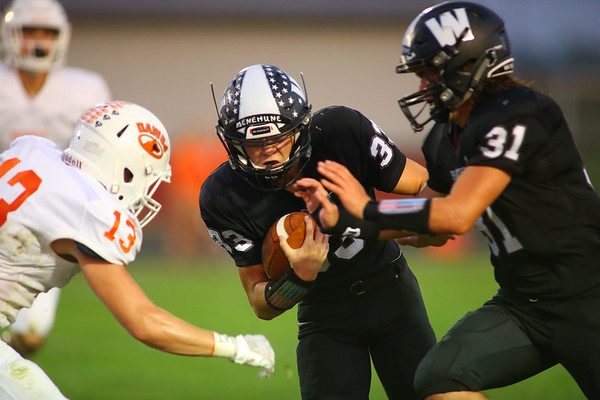 Hunter Cottingham on the run with a block coming from Noah Pownall as Western HS defeats Hamilton Heights HS in their Friday night matchup on Sept. 20, 2019.<br /> Tim Bath | Kokomo Tribune