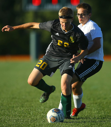 9-26-19<br /> Eastern vs Sheridan boys soccer<br /> Eastern's Evan Spell works in front of a Sheridan defender.<br /> Kelly Lafferty Gerber | Kokomo Tribune