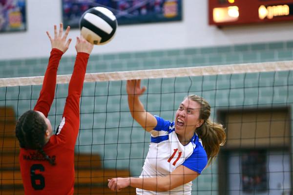Malori Nichols spikes the ball as Kokomo High School volleyball team defeats North Miami High School on Sept. 18, 2019.<br /> Tim Bath | Kokomo Tribune