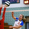 Malori Nichols spikes the ball as Kokomo High School volleyball team defeats North Miami High School on Sept. 18, 2019.<br /> Tim Bath | Kokomo Tribune