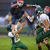 Gabe Eurit jumps over a tackle on a 12 yard run that drew a penalty for the jump as Lewis Cass High School football defeated Benton Central 68-0 on Sept. 6, 2019.<br /> Tim Bath | Kokomo Tribune