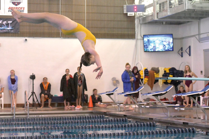 Matthew Gaston | The Sheridan Press<br>Sheridan's Maggie Moseley flips inward for her dive in the tenth round at the 2019 Sheridan Girls Invite Saturday, Sept. 28, 2019.
