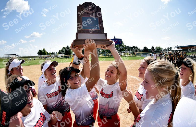 -Messenger photo By Britt Kudla<br /> Fort Dodge celebrates after defeating Cedar Rapids Kennedy during class 5A consolation on Wednesday at Rogers Park