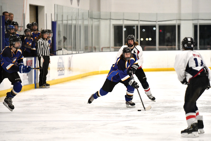Matthew Gaston | The Sheridan Press<br>Sheridan's Hunter Swanson (20) breaks down the ice at the M &amp; M Center against Cheyenne Friday, Feb. 8, 2019.