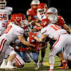 Lumberton Raider David Bathol, 4, fights for every inch against the Carthage Bulldogs for the 4A Area Round Playoff Friday, Nov 22, 2019 in Lumberton, Tx.  Photo: Drew Loker/Special to The Enterprise