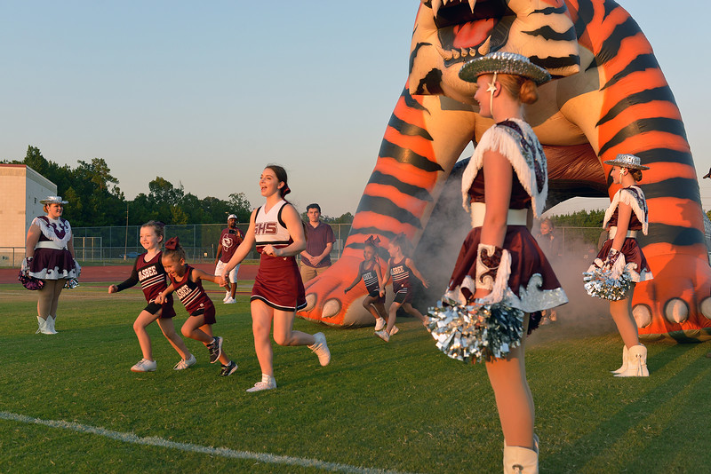 Young Silsbee Tigers open the game running through the Tiger Tunnel as Silsbee hosts the Newton Eagles Friday night in Silsbee. Photo: Drew Loker/Special to The Enterprise
