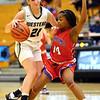 12-8-20<br /> Western vs Kokomo girls basketball<br /> Western's Audrey Rassel takes the ball down the court as Kokomo's Kamaria White puts up defense.<br /> Kelly Lafferty Gerber | Kokomo Tribune