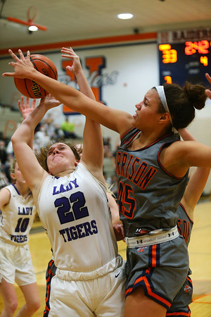 2-5-21<br /> Bailey Henry cannot hold onto the ball while rebounding against Campbell Moore as Northwestern girls loose to Harrison in Friday evenings sectional basketball match up in West Lafayette.<br /> Tim Bath | Kokomo Tribune