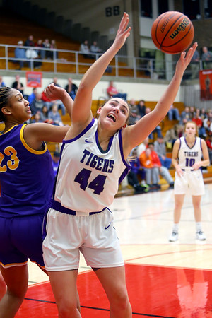 Kendal Bostic rebounds and puts it back up for 2 in the first half of girls sectional basketball at Logansport between Northwestern and Marion HS on February 7, 2020.<br /> Tim Bath | Kokomo Tribune