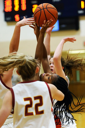 2-5-21<br /> Kamaria White draws a foul early in the game as Kokom girls loose to McCulcheon in Friday evenings sectional basketball match up in West Lafayette.<br /> Tim Bath | Kokomo Tribune