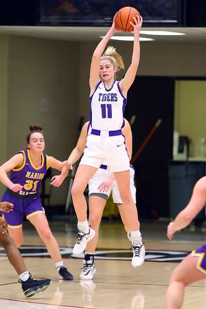 McKenna Layden retrieves a wild ball in the first half of the girls sectional basketball at Logansport between Northwestern and Marion HS on February 7, 2020.<br /> Tim Bath   Kokomo Tribune