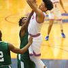 2-6-20<br /> Kokomo vs Arsenal Tech boys basketball<br /> Kokomo's Jarece Rogers shoots.<br /> Kelly Lafferty Gerber | Kokomo Tribune