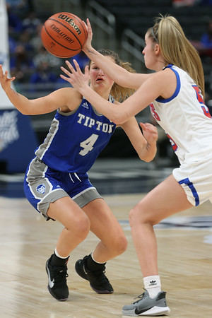 2-26-21<br /> Ella Wolfe goes after a ball the Aubrey Bugess loses as Tipton Blue Devils lose to Linton-Stockton Miners in the class 2A girls State Finals at Bankers Life.<br /> Tim Bath | Kokomo Tribune