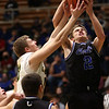 2-25-21<br /> Evan Monize and Owen Duff going for a rebound after an Eastern shot with Eastern HS defeating Carroll 64-53 on Thursday.<br /> Tim Bath | Kokomo Tribune