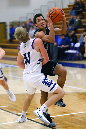 Nathaniel Liddell is fouled by Carroll's Ryan Atkisson during overtime with Western defeating Carroll during basketball action Tuesday February 25, 2020.<br /> Tim Bath | Kokomo Tribune