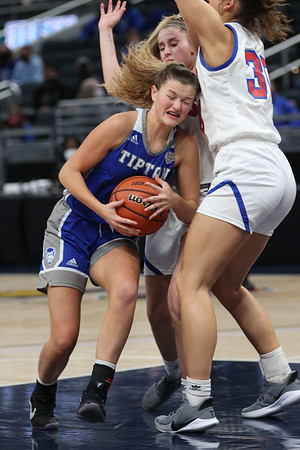 2-26-21<br /> Ella Wolke gets crowded but manages to get a shot off as the Tipton Blue Devils lose to Linton-Stockton Miners in the class 2A girls State Finals at Bankers Life.<br /> Tim Bath | Kokomo Tribune