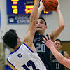 Kyle Sanders shoots for 2 as Western defeats Carroll during basketball action Tuesday February 25, 2020.<br /> Tim Bath | Kokomo Tribune