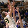 2-25-21<br /> Evan Monize shooting under the basket as Eastern HS defeats Carroll 64-53 on Thursday.<br /> Tim Bath | Kokomo Tribune