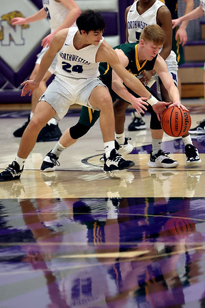 2-13-21<br /> Quentin Yeakel steels the ball from Levi Mavrick giving Northwestern another shot as Northwestern defeats Eastern in Saturday evenings boys basketball matchup 49-44.<br /> Tim Bath | Kokomo Tribune