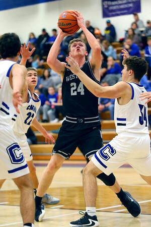 Western defeats Carroll during basketball action Tuesday February 25, 2020. Western's Evan Kretz shooting early in the game.<br /> Tim Bath | Kokomo Tribune